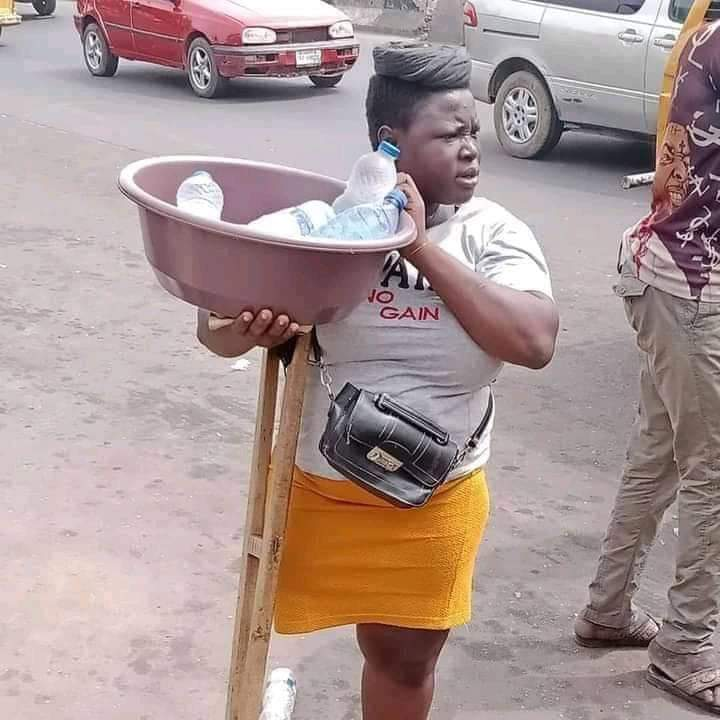 Young lady with disability selling sachet water in viral photos, gets cash gift